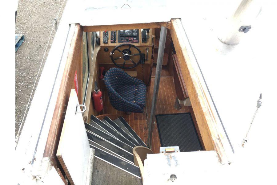De Groot 10m steel diesel cruiser - stairs down to saloon
