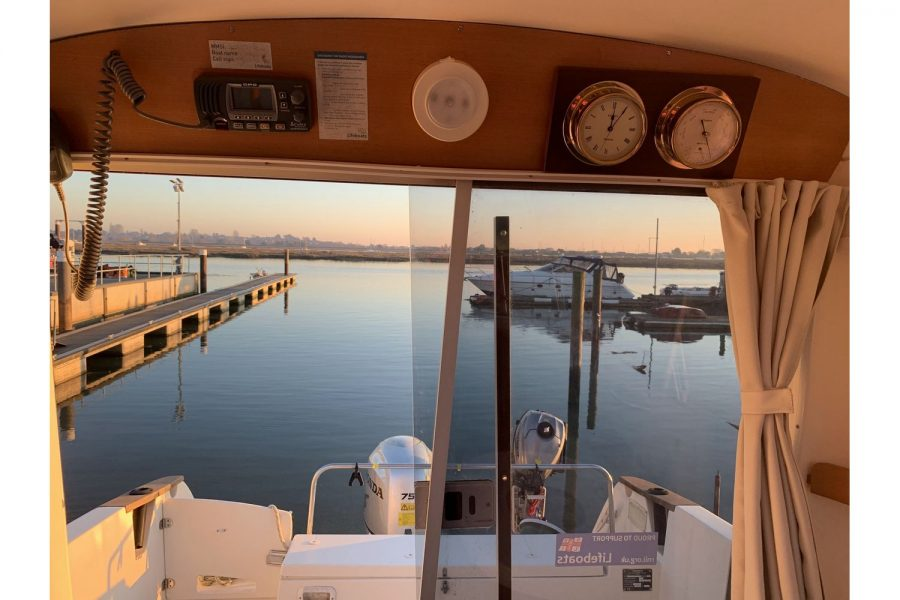 Ocqueteau 6.15 - aft view from wheelhouse with VHF radio, clock and barometer