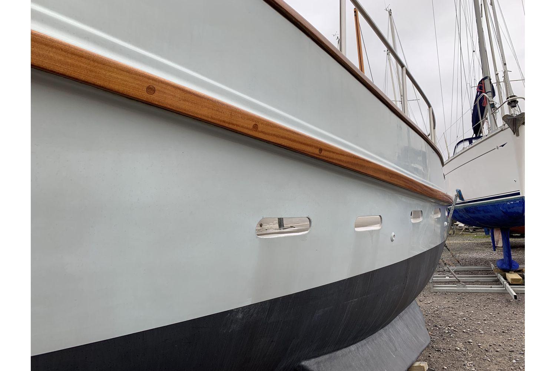 Freeward 30 fishing boat - wooden keel band