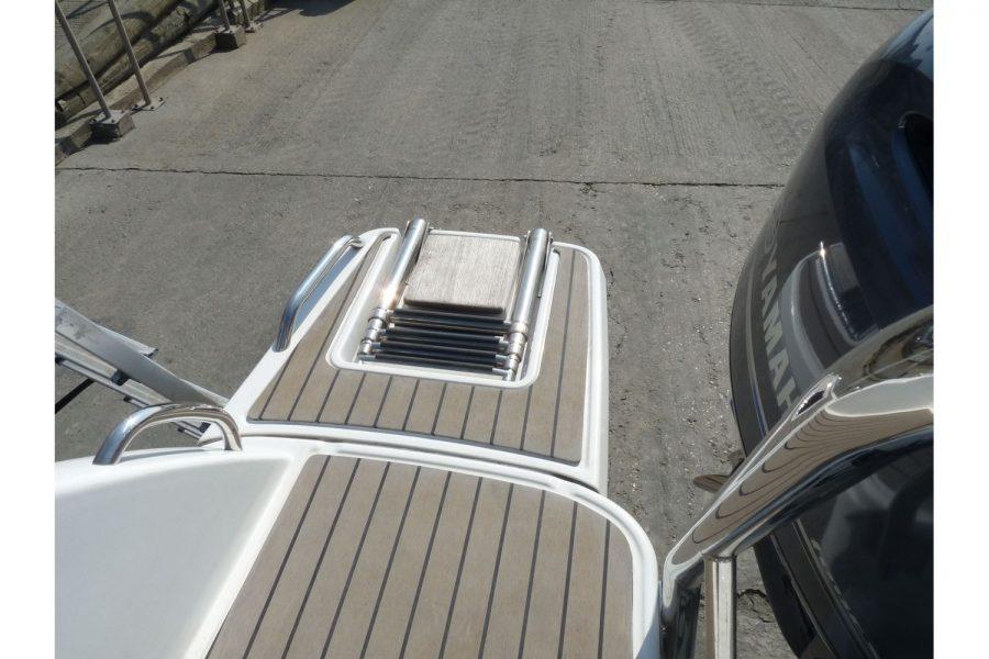 Jeanneau Cap Camarat 6.5BR - folding boarding ladder