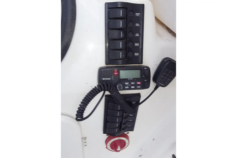 Warrior 175 fishing boat - VHF radio and switch panels