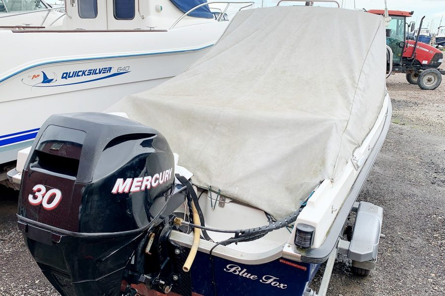 Orkney 520 fishing boat - aft view with overall cover