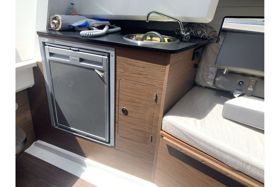 Jeanneau Cap Camarat 7.5 WA - galley with fridge and sink