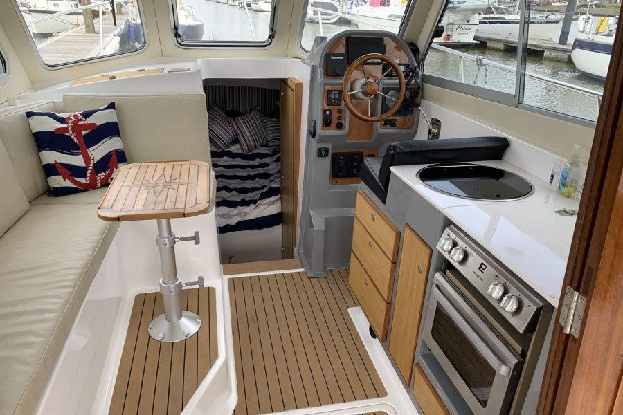 Jersey 30 motor cruiser - wheelhouse helm, salon and galley