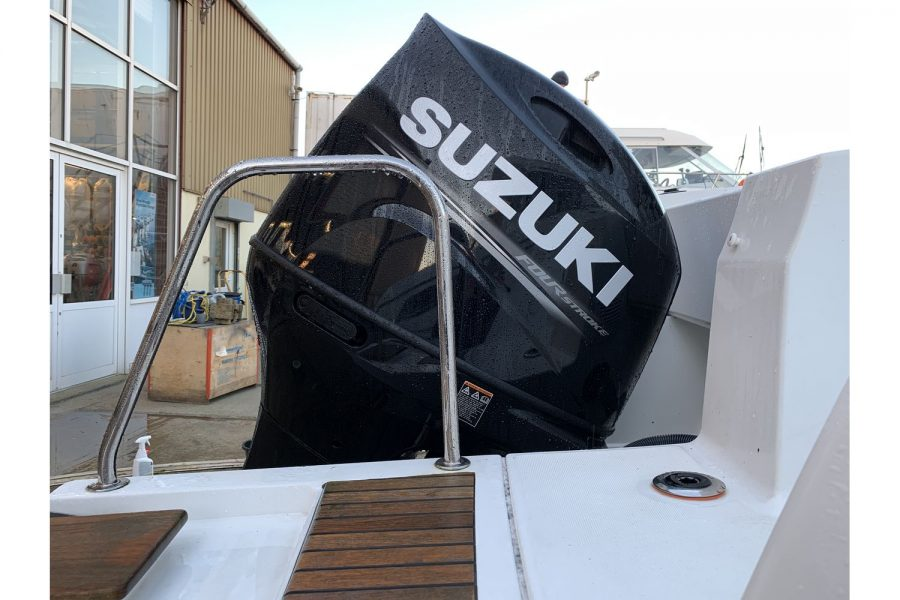 Jeanneau Merry Fisher 695 - Suzuki outboard view from swim platform