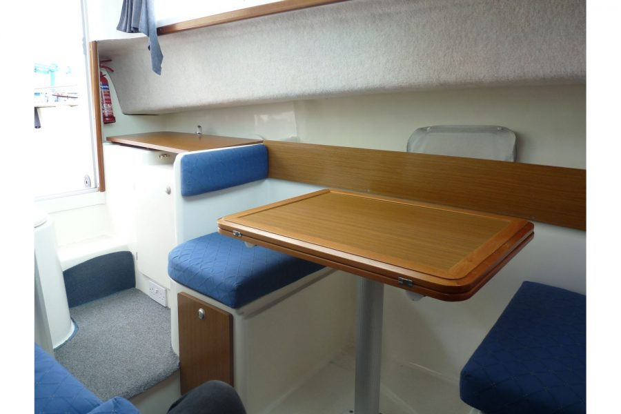 Jeanneau Merry Fisher 695 diesel - port side table converts to berth