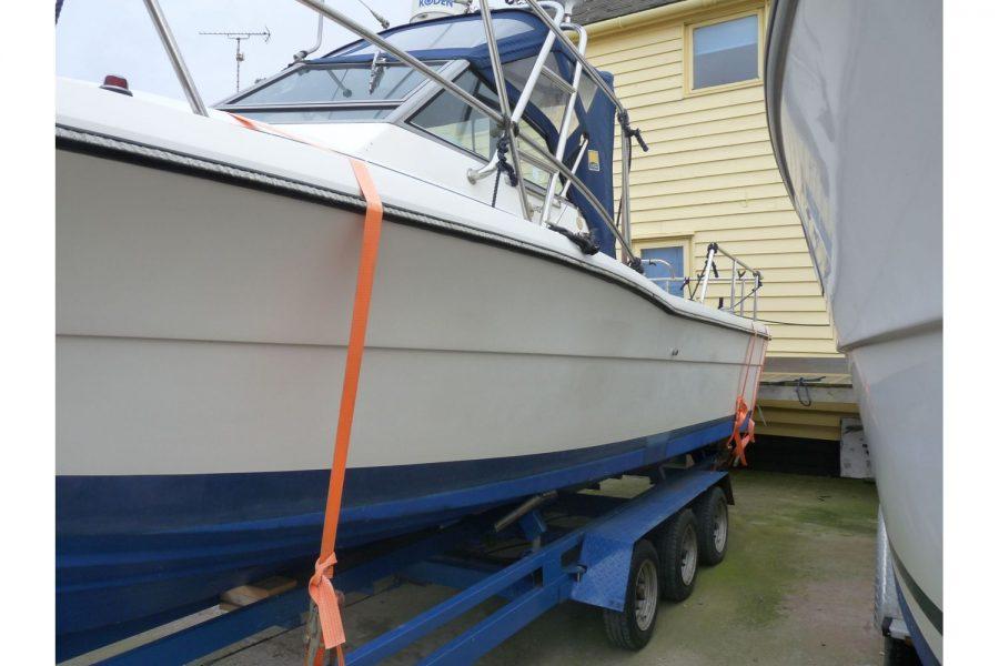 Pursuit 2350 fishing boat - port side