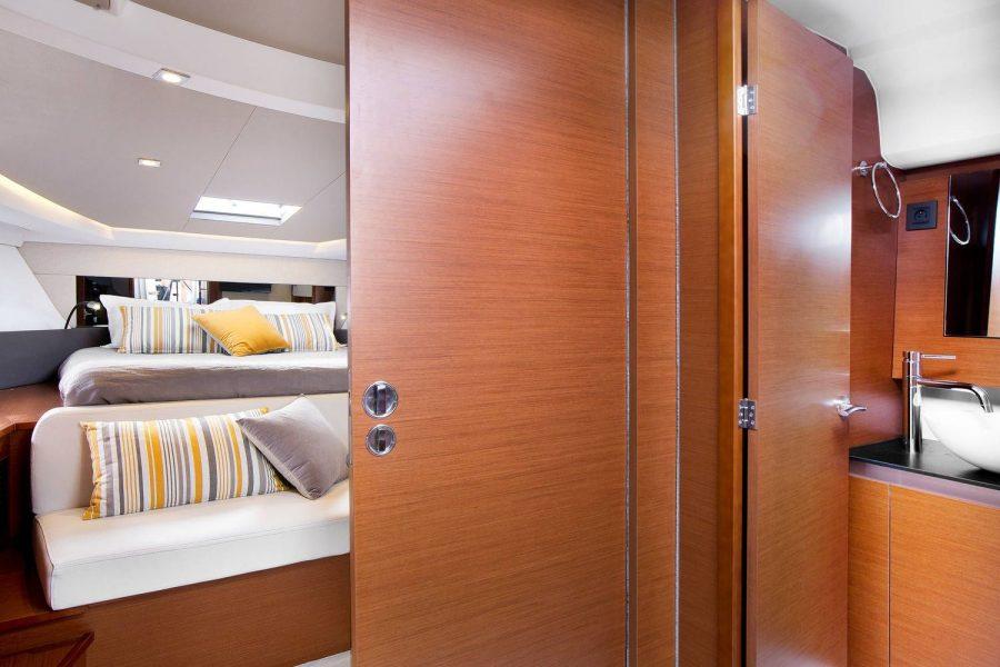 Jeanneau Leader 36 diesel sports cruiser - sliding door to forward cabin