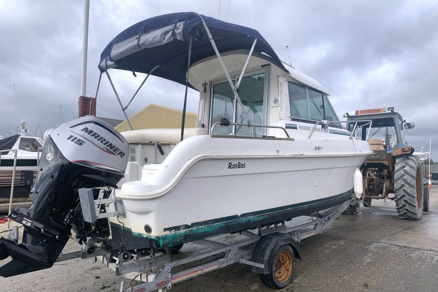 Jeanneau Merry Fisher 625 fishing boat - aft canopy and Mariner 115 outboard
