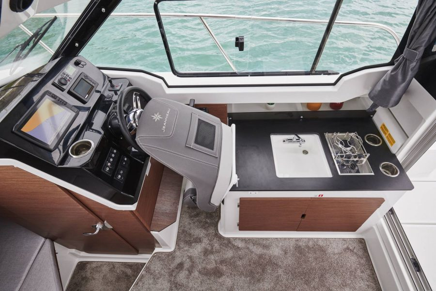 Jeanneau Merry Fisher 795 - helm seat folds forward for galley