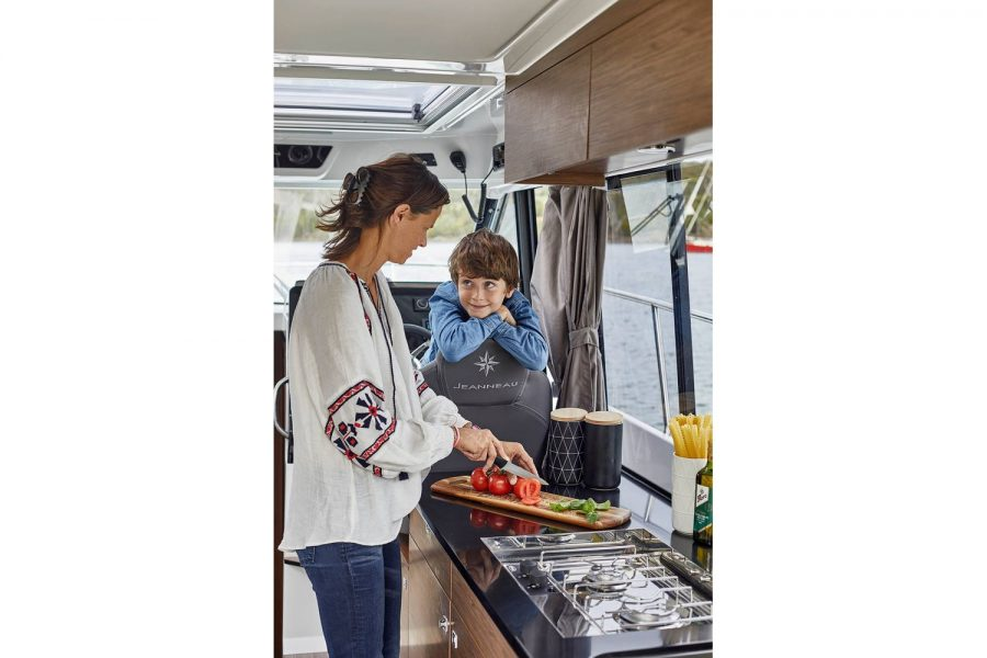 Jeanneau Merry Fisher 1095 wheelhouse fishing boat - preparing food in the galley