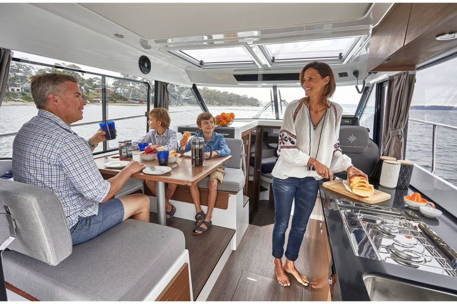 Jeanneau Merry Fisher 1095 wheelhouse fishing boat - galley and saloon table