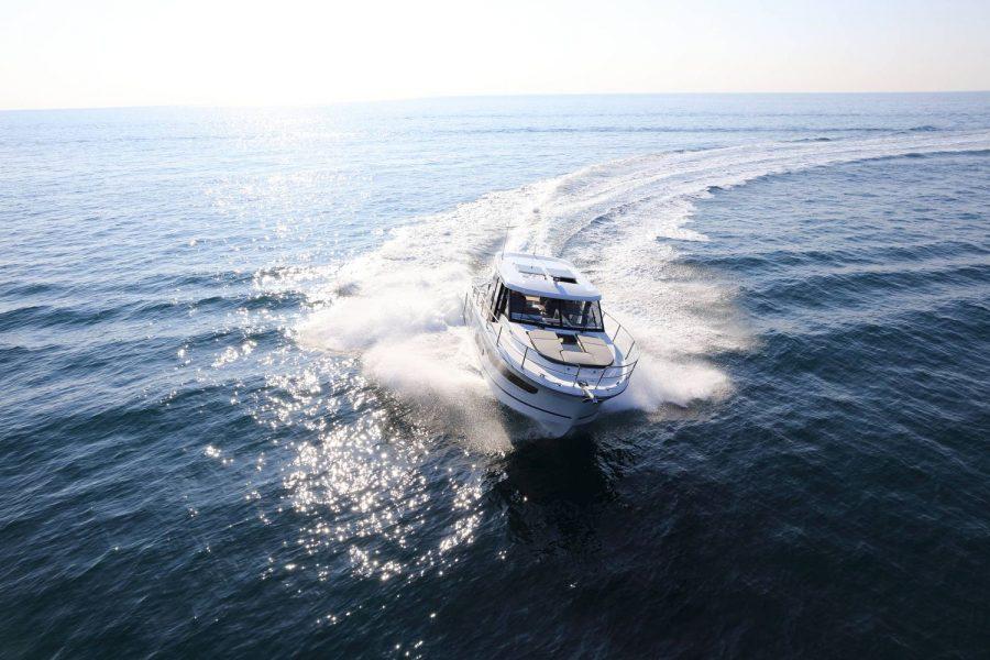 Jeanneau Merry Fisher 1095 wheelhouse fishing boat - on the water