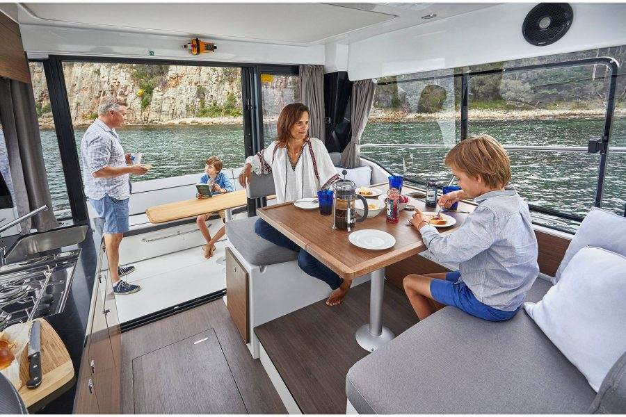 Jeanneau Merry Fisher 1095 wheelhouse fishing boat - view from wheelhouse saloon to aft seating