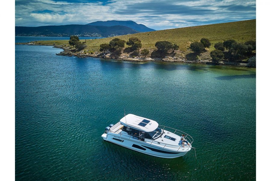 Jeanneau Merry Fisher 1095 wheelhouse fishing boat - on the water with beautiful scenery
