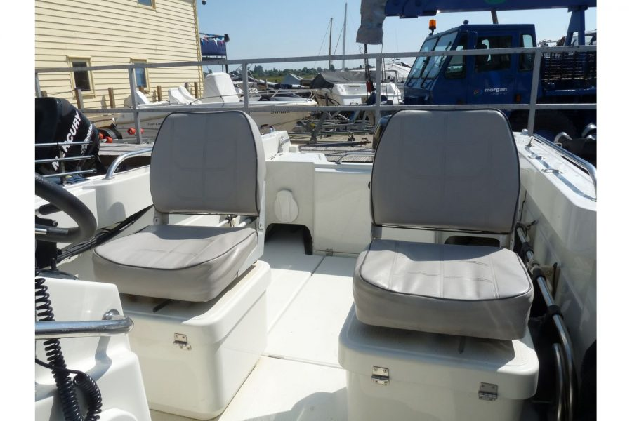 Orkney 522 fishing boat - helm and co-pilot seats looking to aft